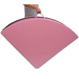 pink round pole dancing crash mat folded with handles side view