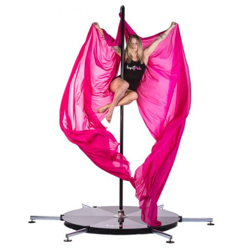 A woman practicing aerial fitness on a pink silk attached to a Lupit stage.